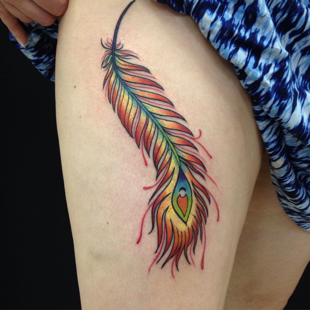 Feather tattoos for women on the thigh