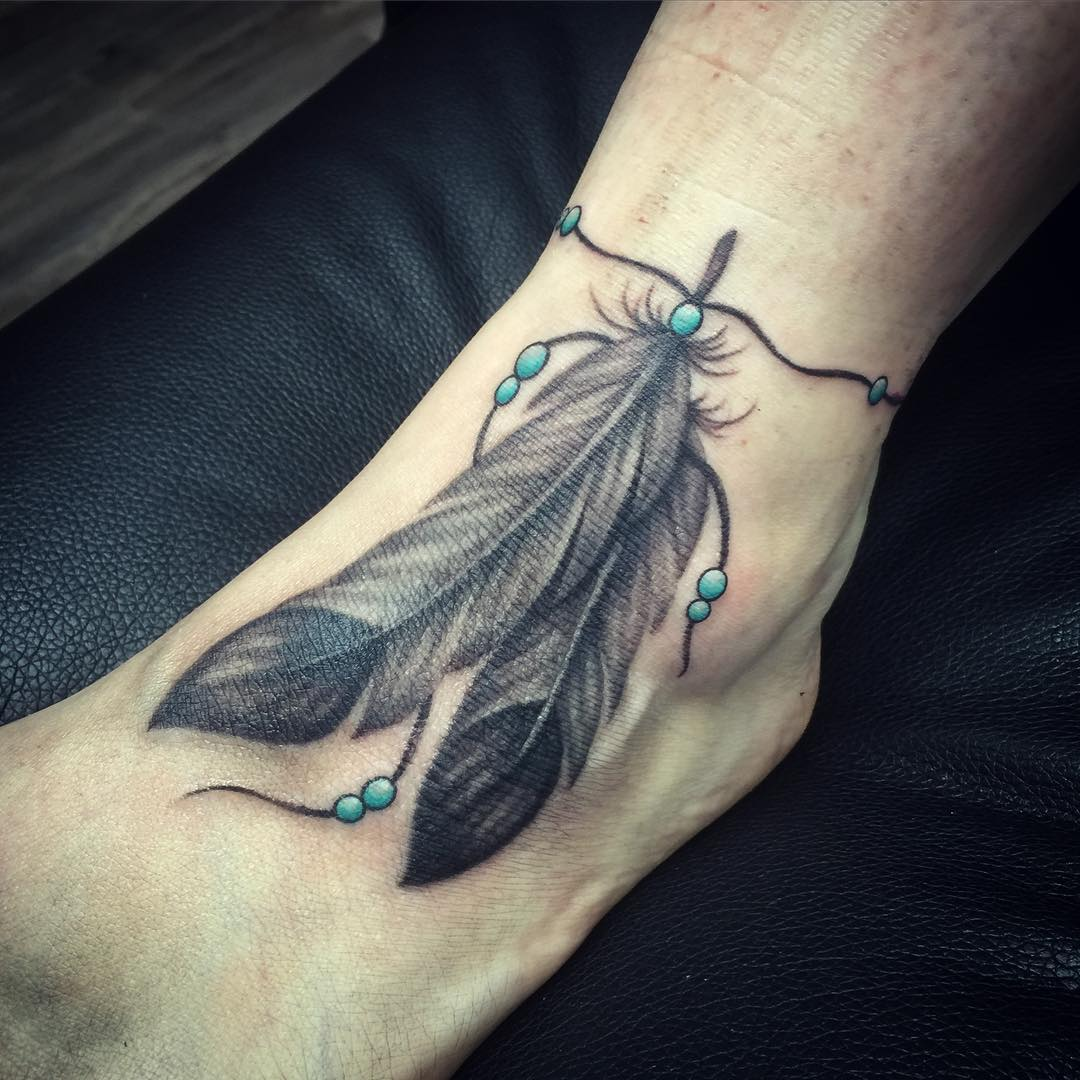 Feather tattoos on feet