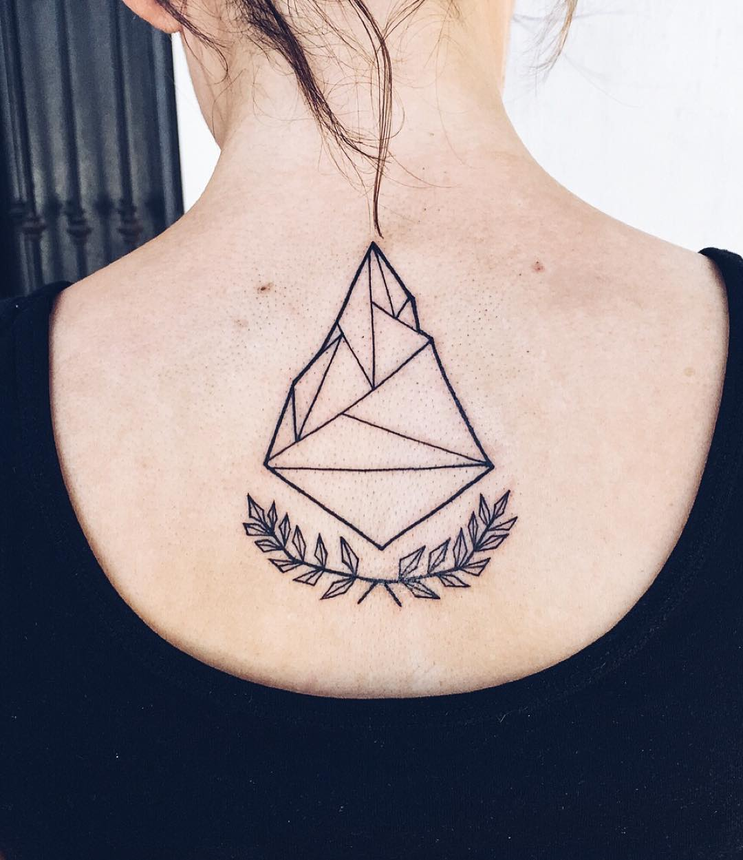 Geometric Tattoo on back of shoulder