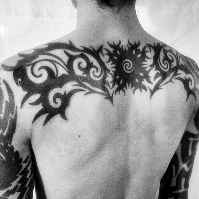 the 21 best tribal tattoos for men to follow. Black Bedroom Furniture Sets. Home Design Ideas