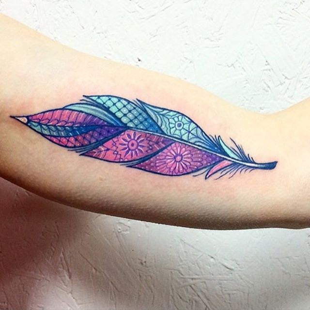 colorfull feather tattoo designs on outer arm