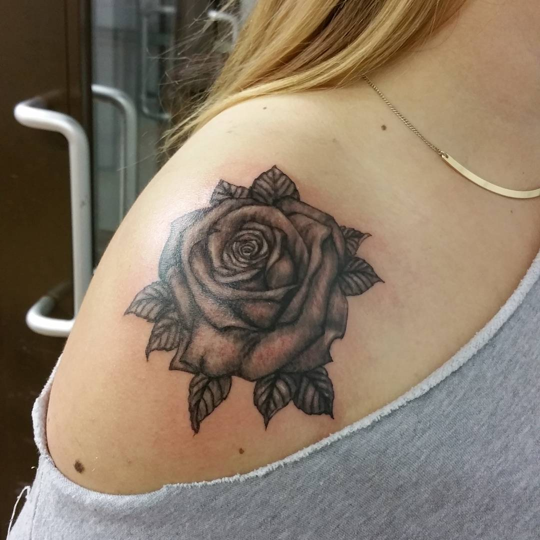 cute rose tattoo on shoulders