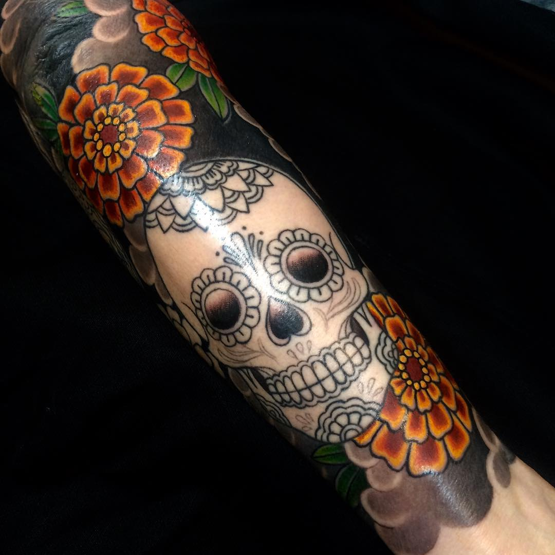 japanese skull and flower tattoo on sleeve