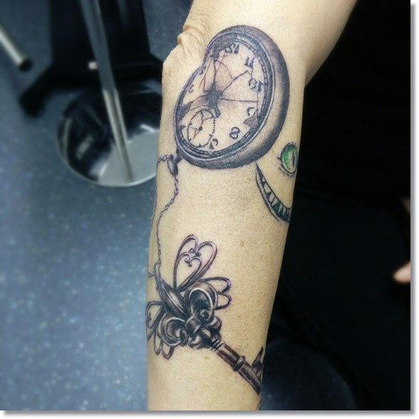 meaning of pocket watch tattoo with key