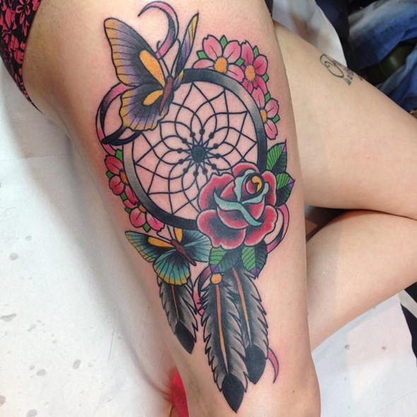 old school dreamcatcher tattoos on thighs