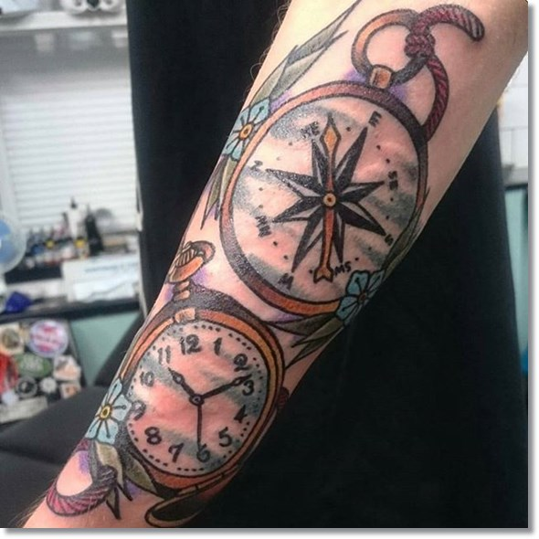 pocket watch compass tattoo on sleeve