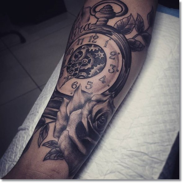 pocket watch tattoo design on forearm