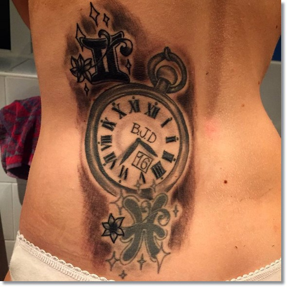 pocket watch tattoo for women on lower back