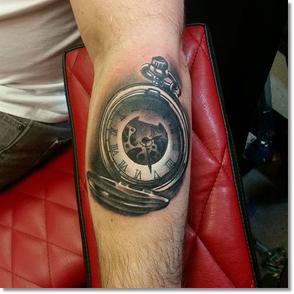 pocket watch tattoo on forearm