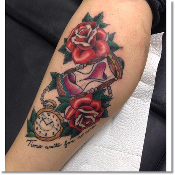 rose and pocket watch tattoo on leg