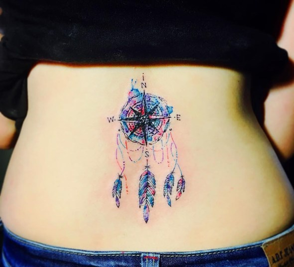 small dreamcatcher tattoo on lower back