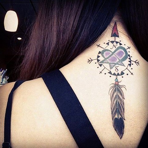 small native feather tattoo