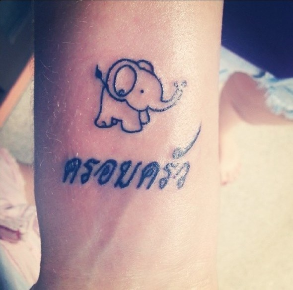 tiny elephant tattoo with name