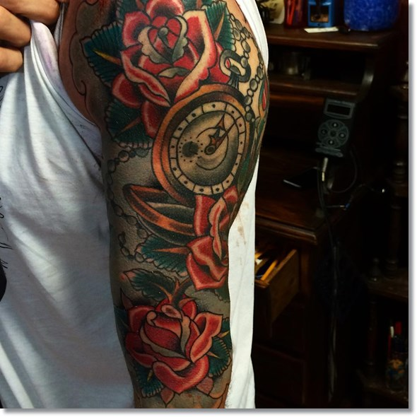 traditional pocket watch tattoo with roses