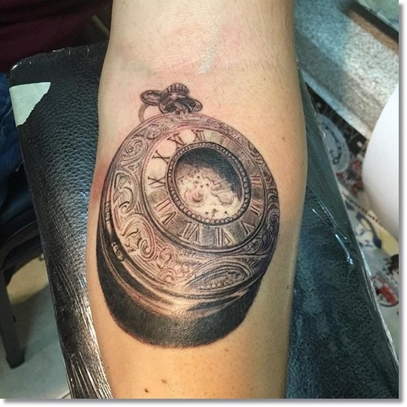 vintage 2015 pocket watch tattoo on forearm