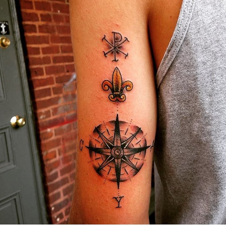 Compass-rose-with-Chi-Rho-on-back-of-arm-representing-journey-and-relationship-with-the-Good-Lord