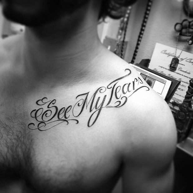 Freehand script collar bone tattoos for guys