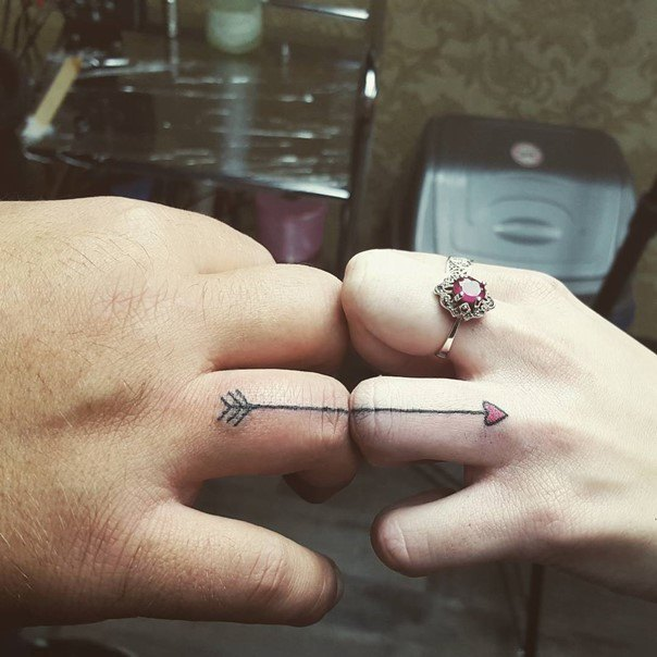 arrow wedding ring tatoo