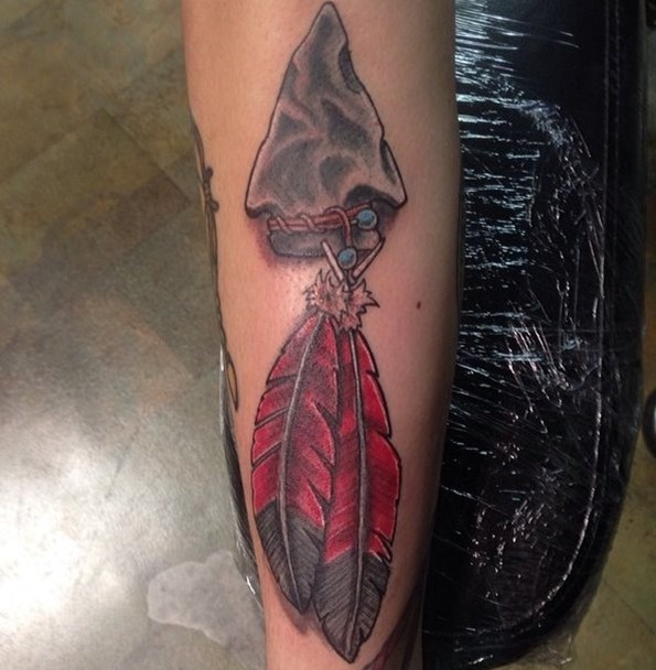 arrowhead feather tattoo with red lotus color