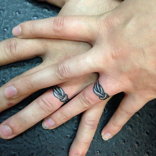 barbed wire wedding band tattoo