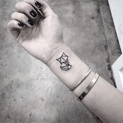 geometric-tiny-fox-tattoo-design-on-wrist