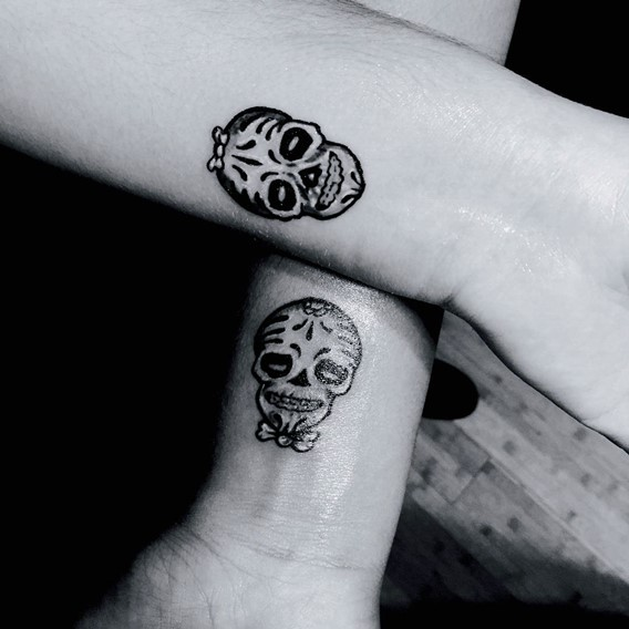 his and hers matching sugar skulls tattoos