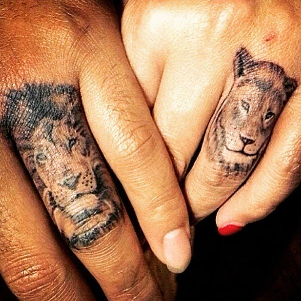 lion themed wedding ring tattoo
