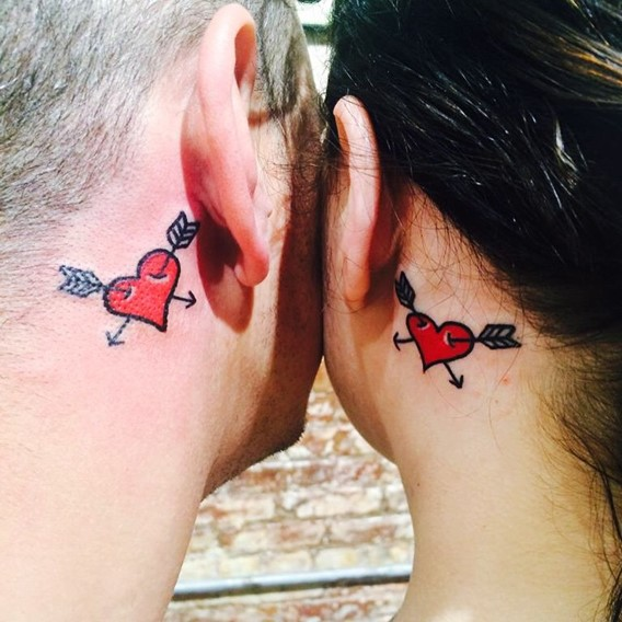 matching his and her tattoos behind the ears