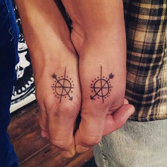 matching his and hers compass tattoos