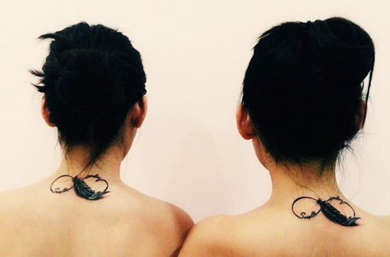 matching sisters infinity feather tattoo on back