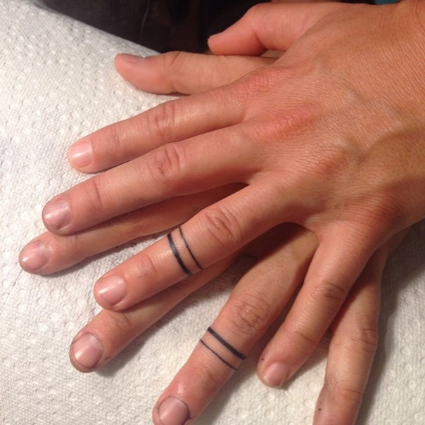 ring finger wedding band tattoos