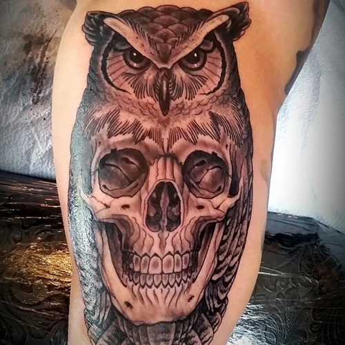 skull inside owl tattoo on sleeve