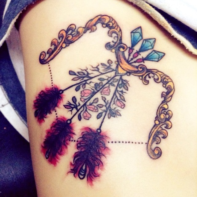 traditional-bow-and-arrow-tattoo-feathers-with-flowers