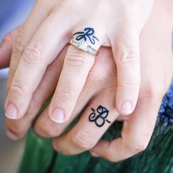 35 sweet simple wedding band tattoos for Wedding ring tattoos cost