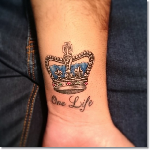 Small crown tattoo on wrist with quote
