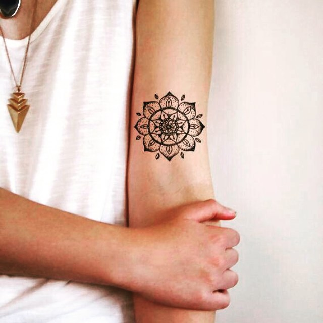 Small mandala tattoo on sleeve