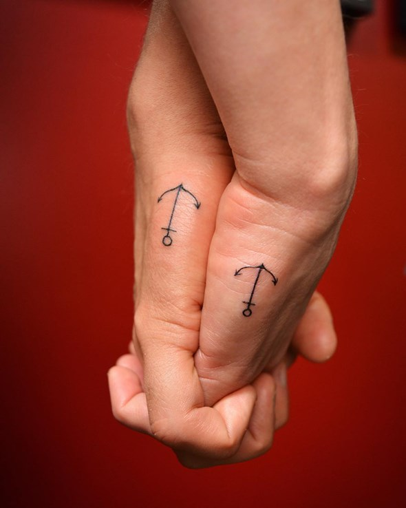 anchor tattoos between brother and sister
