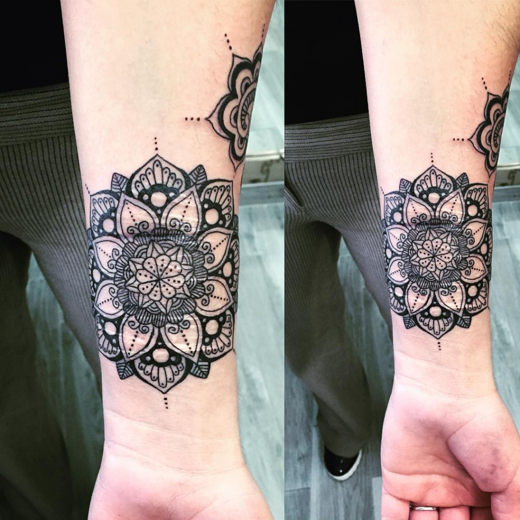 black mandala tattoo patterns on wrist