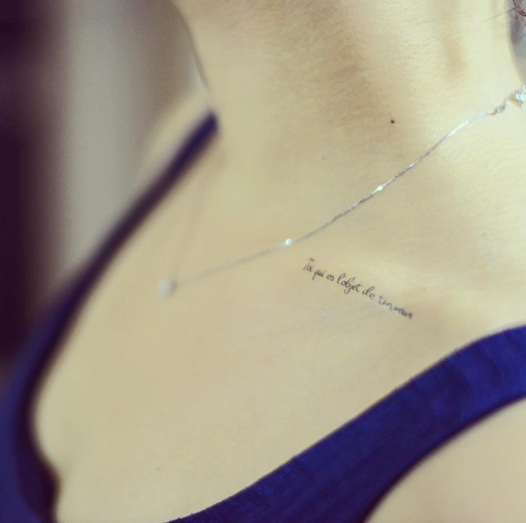 collar bone quote tattoos for girls