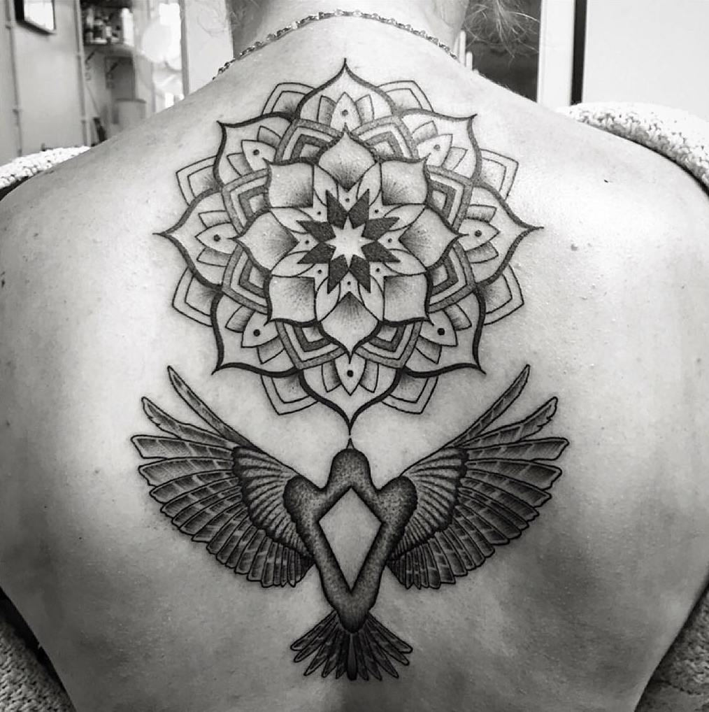 mandala bird tattoo