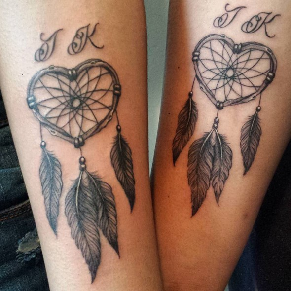 matching small dreamcatcher forearm tattoo