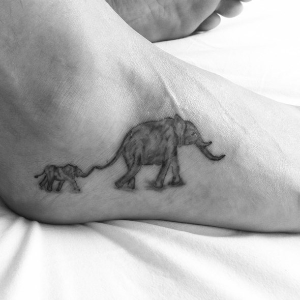small black and grey elephant tattoo