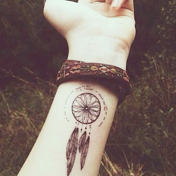 small dream catcher wrist tattoo