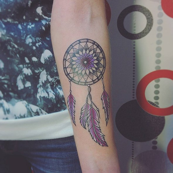 small dreamcatcher tattoo design on forearm