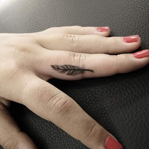 small feather tattoo finger