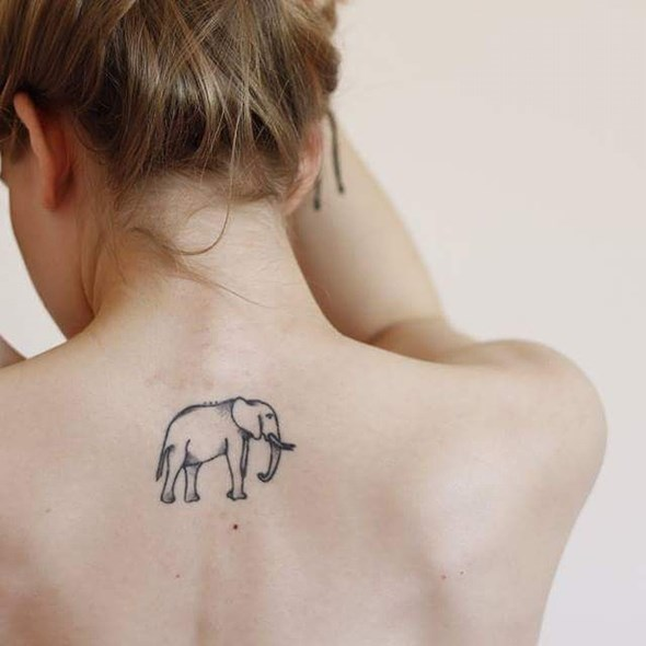 small simple elephant tattoo on back