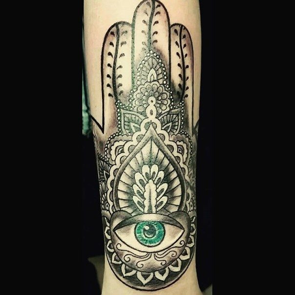 Hamsa hand tattoo protection against the evil eye