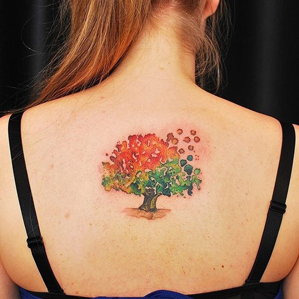 Watercolor style tree tattoo girl back