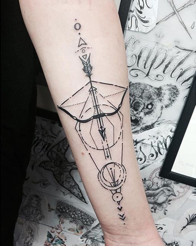 geometric-bow-and-arrow-tattoo-symbolism