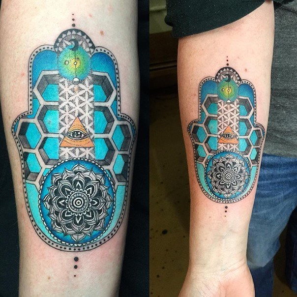 hamsa hand tattoo in color on forearm
